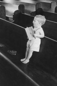 child singing in pew
