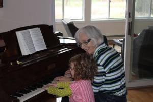 Nancy Roberts at piano with grand